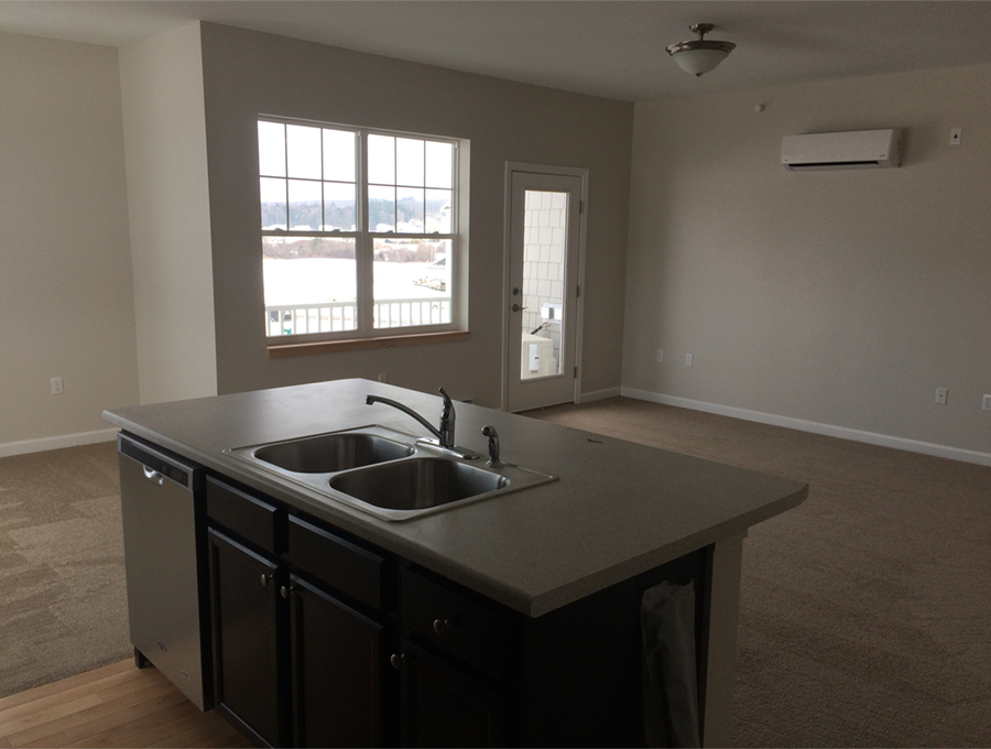 Kitchen island facing living area.